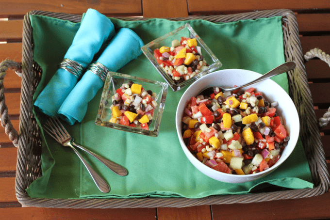 This black bean and mango salad is bursting with colors, flavors and freshness and can be used as a salsa with chips or served on grilled chicken, fish or meat!