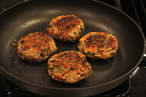Fiesta black bean burgers cooking