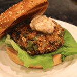Fiesta black bean burger with spiced yogurt sauce