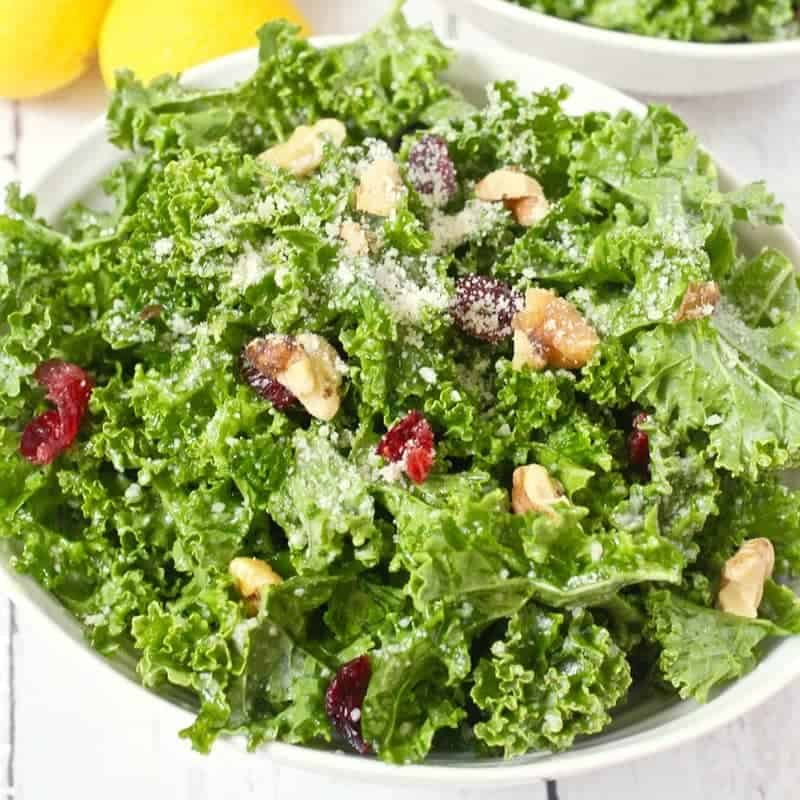 Citrus kale salad - an easy massaged kale salad with walnuts, dried cranberries, Parmesan and a hint of sweetness! | FamilyFoodontheTable.com