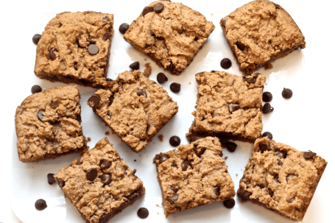 Peanut butter chocolate chip snack bars scattered on a white plate