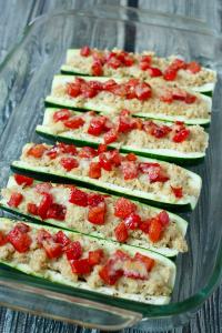 Quinoa and hummus stuffed zucchini