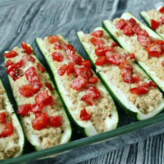 Quinoa and hummus stuffed zucchini | FamilyFoodontheTable.com