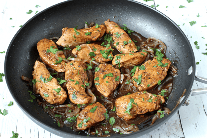 Sliced chicken breasts in a balsamic vinegar sauce in a pan
