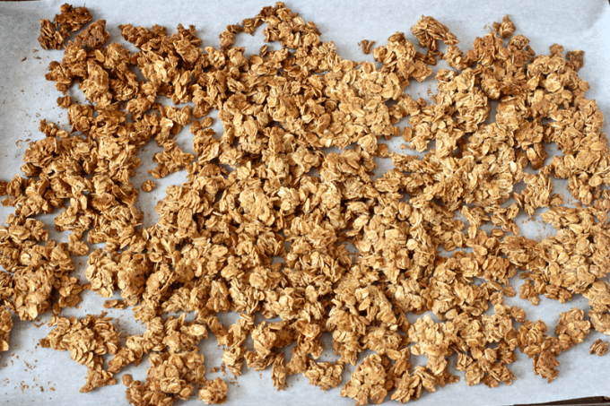 5-ingredient homemade granola baked on a baking sheet