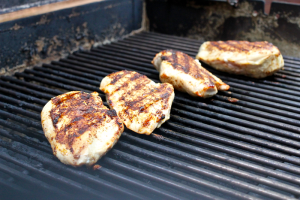 Chicken breasts being cooked on the grill