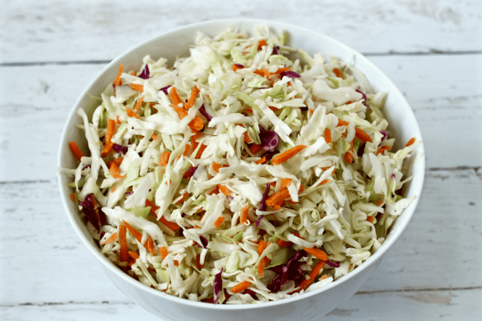 This 3-ingredient, easy no mayo coleslaw is great on pulled pork or BBQ chicken sandwiches, in tacos or as a side dish when grilling out! It hits the spot for a healthier, lightened up coleslaw!
