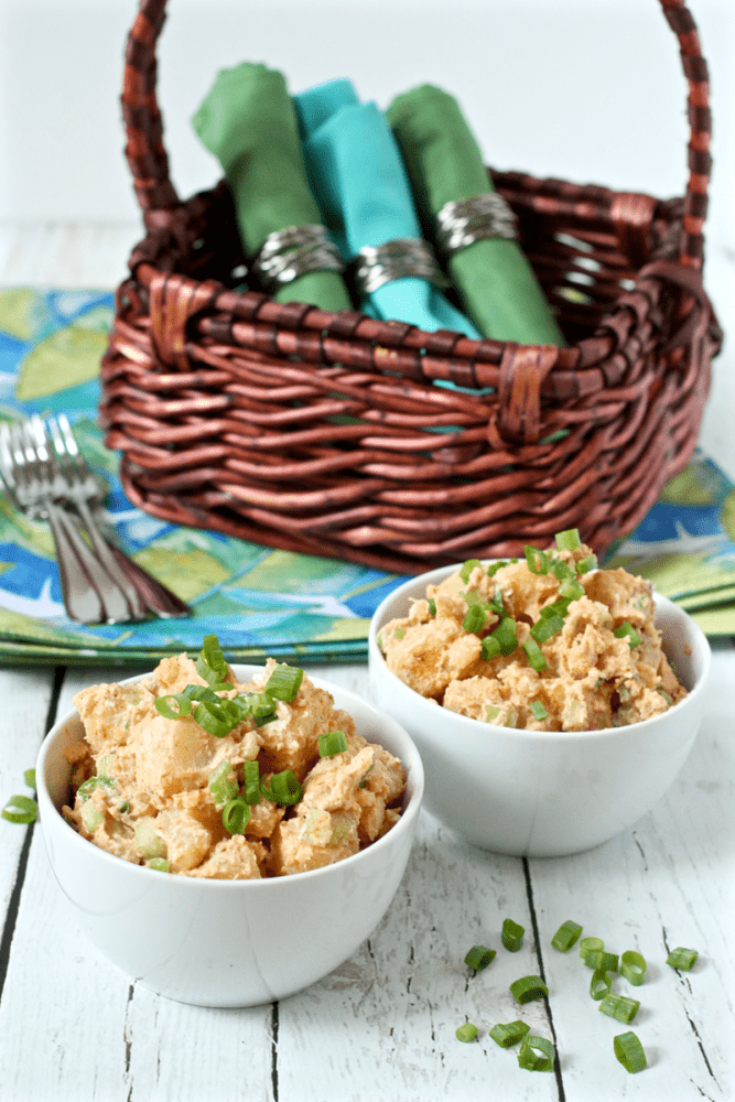 Perfectly creamy potato salad is lightened up with half mayo and half Greek yogurt. It's perfect for BBQ parties, picnics, cookouts and potlucks all summer long!