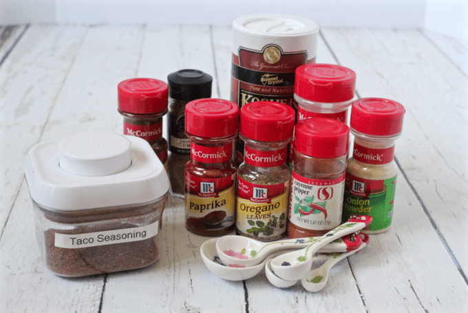 Spices set out to make homemade taco seasoning
