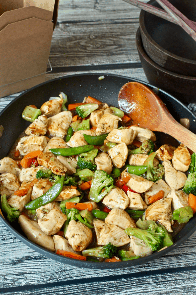 A quick and easy chicken and veggie stir fry with just a few ingredients - perfect for a busy weeknight. No more takeout needed! #stirfry #chickendinner #easyrecipe #easychickenrecipe