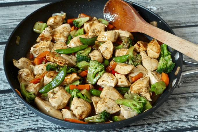 Chicken stir fry with vegetables in a saute pan