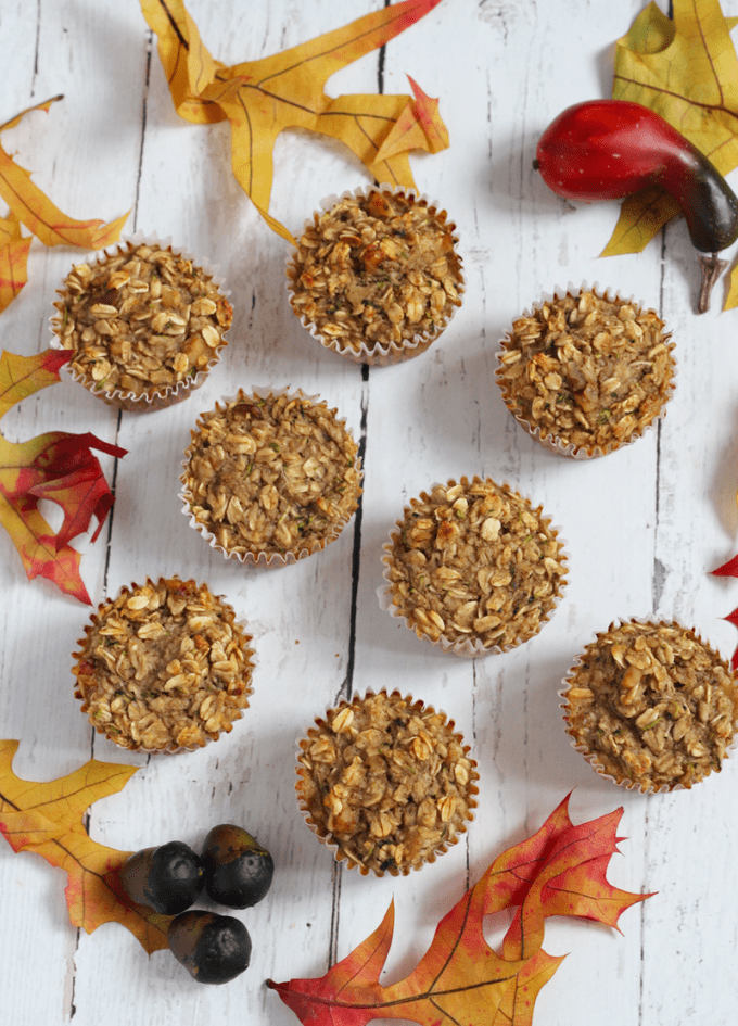 Healthy harvest zucchini muffins are made with oats, banana, applesauce and zucchini! They are gluten-free and great for breakfast, school lunch or a snack! | FamilyFoodontheTable.com