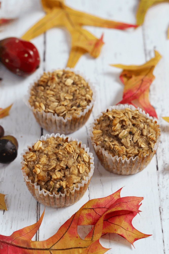 Harvest zucchini muffins are full of goodness with oats, banana, applesauce and zucchini!   FamilyFoodontheTable.com
