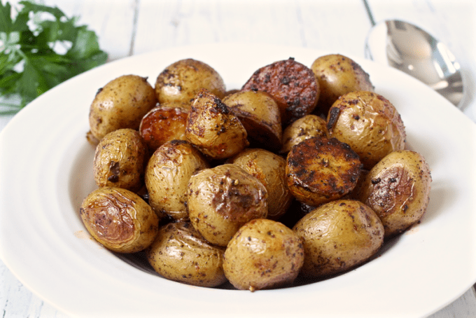 Roasted potatoes with paprika served piled up in a white bowl
