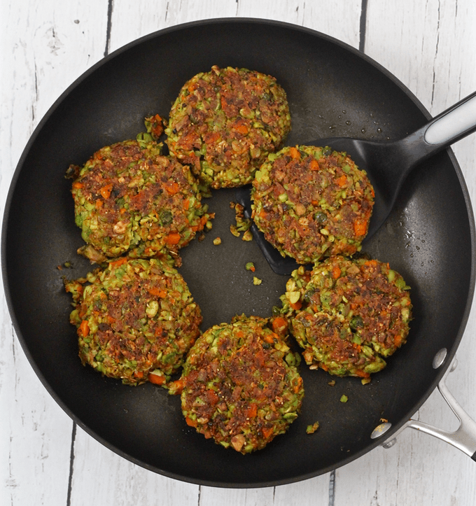 Simple veggie burgers cooking in a pan