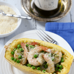 Spaghetti squash with pesto, peas and shrimp