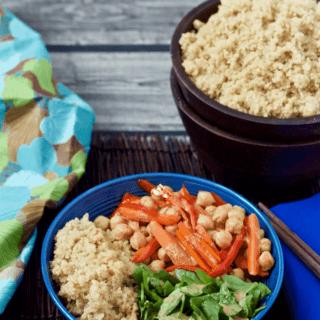 Quinoa veggie Buddha bowl with lemon-tahini dressing - a 15-minute vegetarian meal that's light but filling! | FamilyFoodontheTable.com