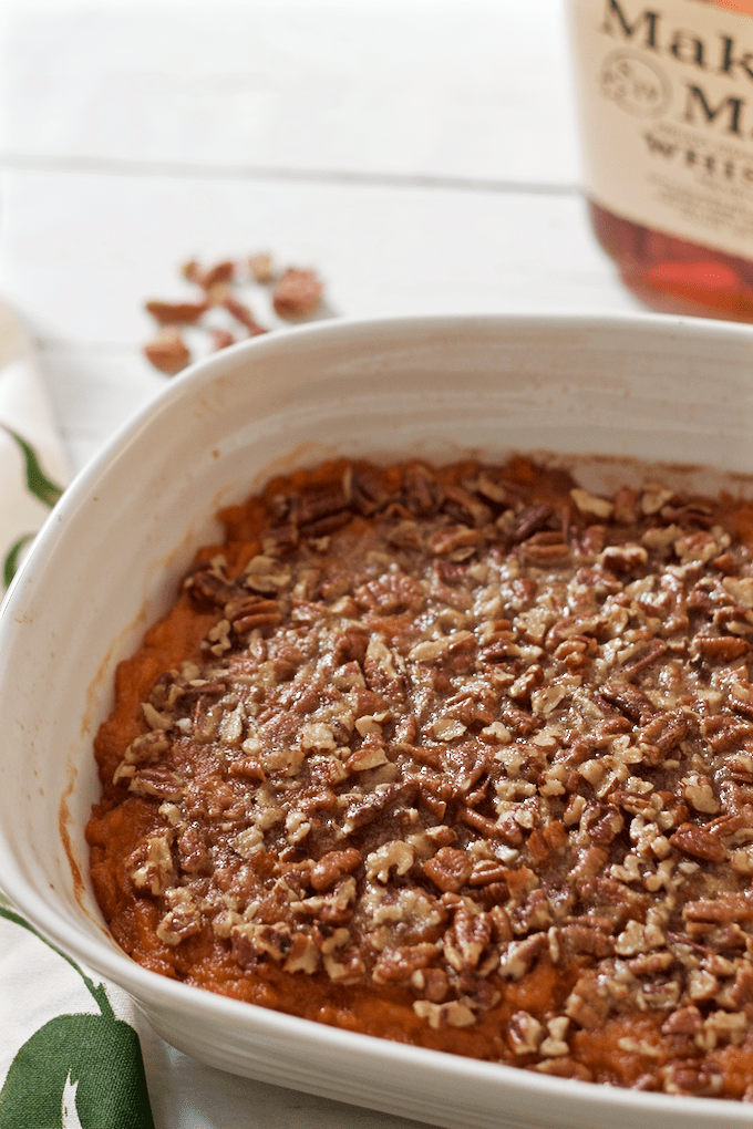 Bourbon sweet potato casserole with a buttery pecan crust - lightened up slightly with less sugar and butter for a not-too-sweet holiday side dish | FamilyFoodontheTable.com
