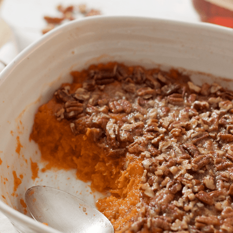 Bourbon sweet potato casserole with a buttery pecan crust - lightened up slightly with less sugar and butter for a not-too-sweet Thanksgiving side dish | FamilyFoodontheTable.com