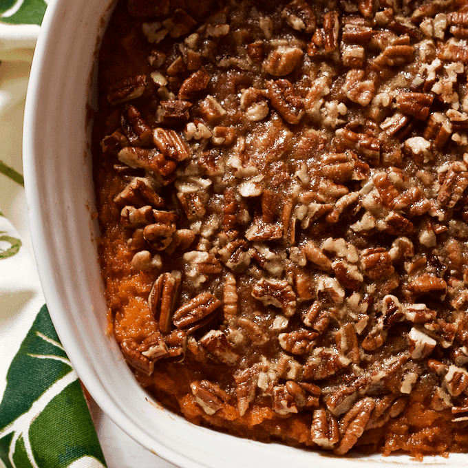 This bourbon sweet potato casserole with buttery pecans has a little less sugar and butter for a boozy, not-too-sweet holiday side dish! #bourbon #sweetpotato #casserole #thanksgivingdinner #holidayfood