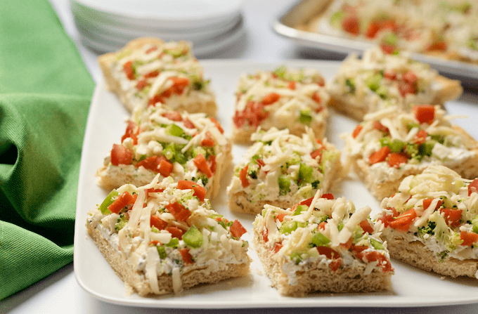 Easy vegetable squares served on a white platter