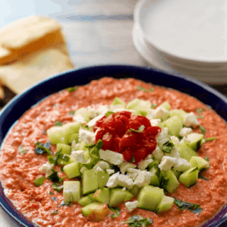 Holiday hummus - Roasted red pepper hummus gets dressed up with chopped cucumber and feta cheese for an easy, but fancy, holiday appetizer! | FamilyFoodontheTable.com