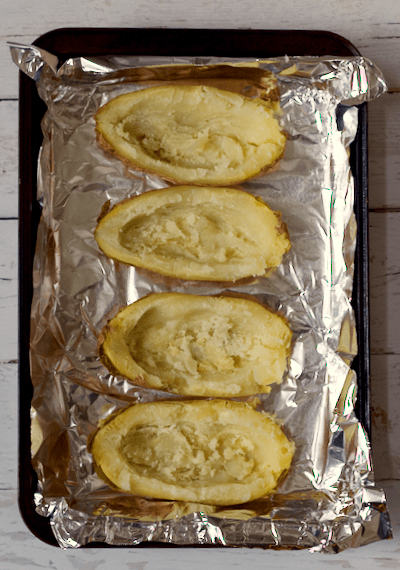 Fast cheesy chicken and broccoli twice-baked potatoes | FamilyFoodontheTable.com
