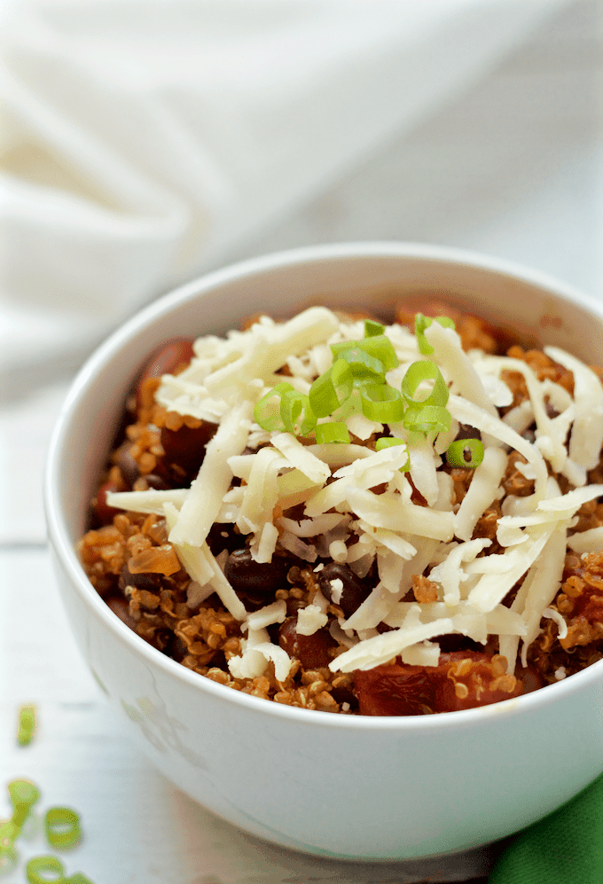 This hearty vegetarian quinoa chili has such deep color and flavor that it'll be a hit with meat eaters and vegetarians alike! Just 30 minutes to make and no need to pre-cook the quinoa! #vegan #vegetarian #chili #quinoa