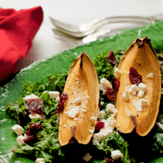 Roasted acorn squash and kale salad with feta cheese and dried cranberries - a festive holiday side dish! | FamilyFoodontheTable.com