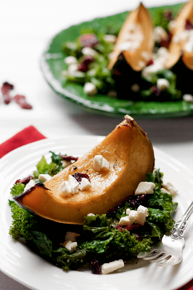 Roasted acorn squash and kale salad with feta cheese and dried cranberries | FamilyFoodontheTable.com