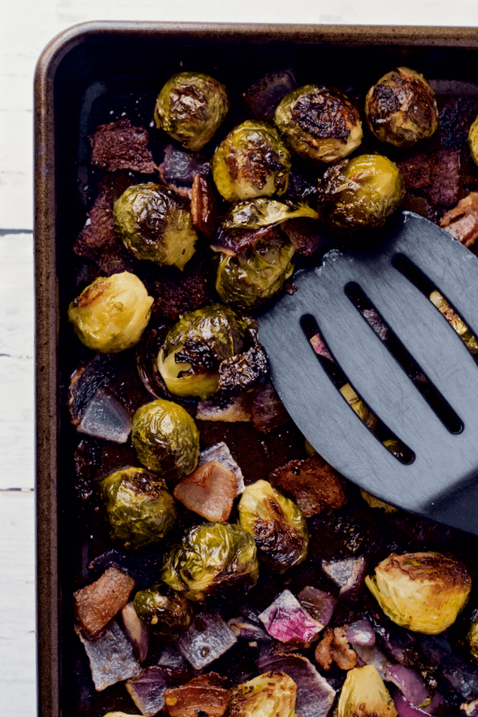 Roasted Brussels sprouts with bacon and red onion - an easy, delicious side dish! | FamilyFoodontheTable.com