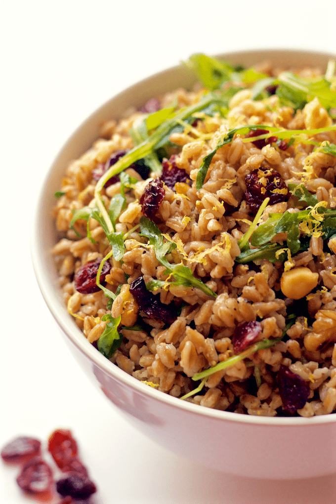 A fast and easy citrus farro salad with arugula, walnuts and dried cranberries | FamilyFoodontheTable.com