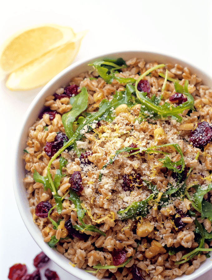 A quick and easy citrus farro salad with arugula, walnuts and dried cranberries | FamilyFoodontheTable.com