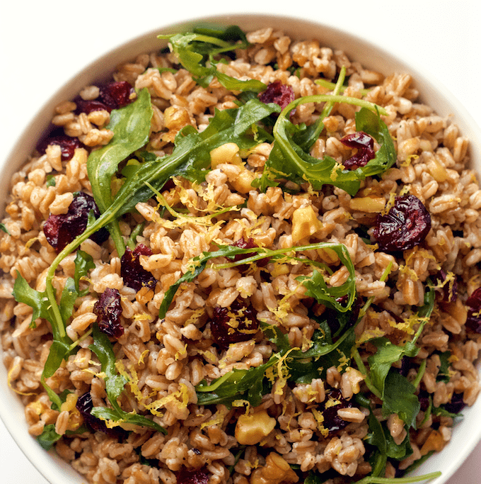 A fast and easy citrus farro and arugula salad with walnuts and dried cranberries | FamilyFoodontheTable.com