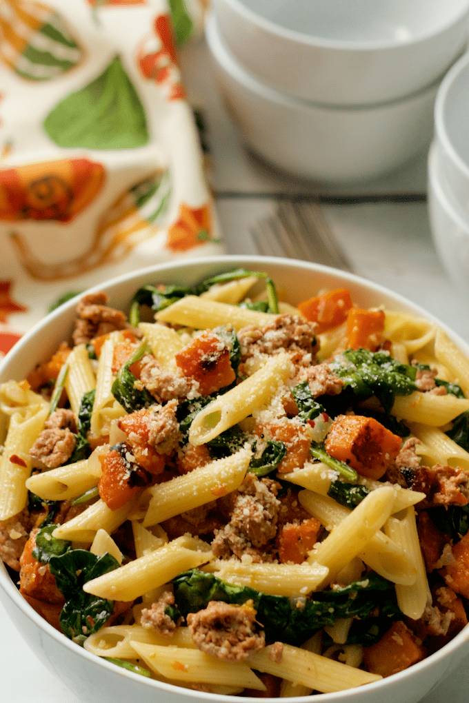 A flavorful all-in-one dinner of turkey sausage, roasted butternut squash and spinach with gluten-free pasta | FamilyFoodontheTable.com