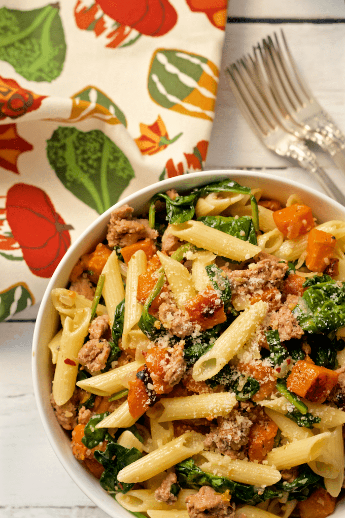 A gluten-free pasta dinner with turkey sausage, roasted butternut squash and spinach | FamilyFoodontheTable.com