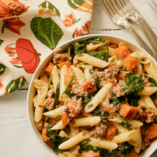 Turkey sausage, butternut squash and spinach gluten-free pasta - an all-in-one dinner with big flavor that everyone can enjoy! | FamilyFoodontheTable.com