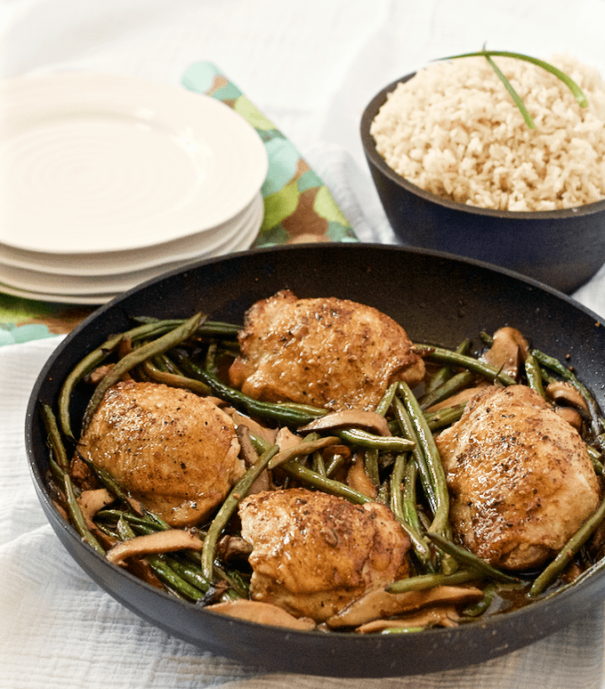 A one-skillet, 30-minute dinner of browned chicken thighs with shiitake mushrooms and French green beans | FamilyFoodontheTable.com