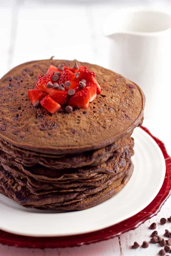 These healthy chocolate pancakes are whole wheat, naturally sweetened and made without butter or oil. They're great for a fun and special breakfast! #chocolatebreakfast #chocolatepancakes #pancakes
