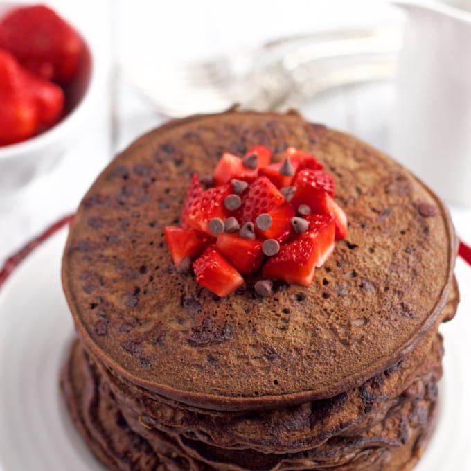 Whole wheat, naturally sweetened chocolate pancakes, with no butter or oil for a healthy, fun breakfast! | FamilyFoodontheTable.com