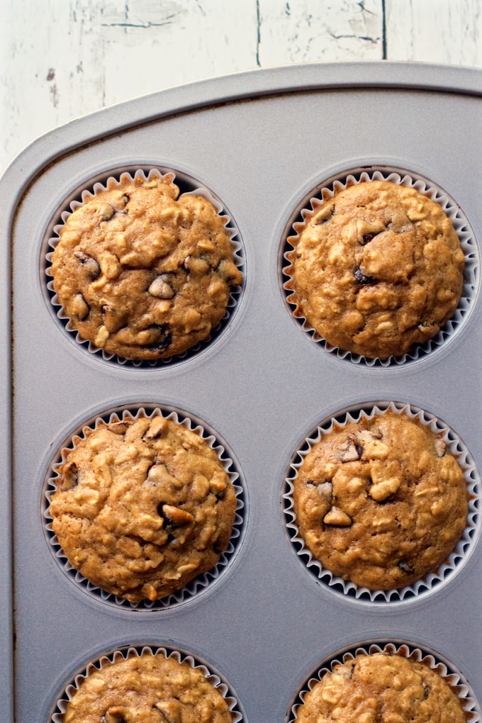 Healthy chocolate chip muffins are loaded with whole grains, just a tiny bit of butter and make a fun breakfast treat or easy afternoon snack! | FamilyFoodontheTable.com