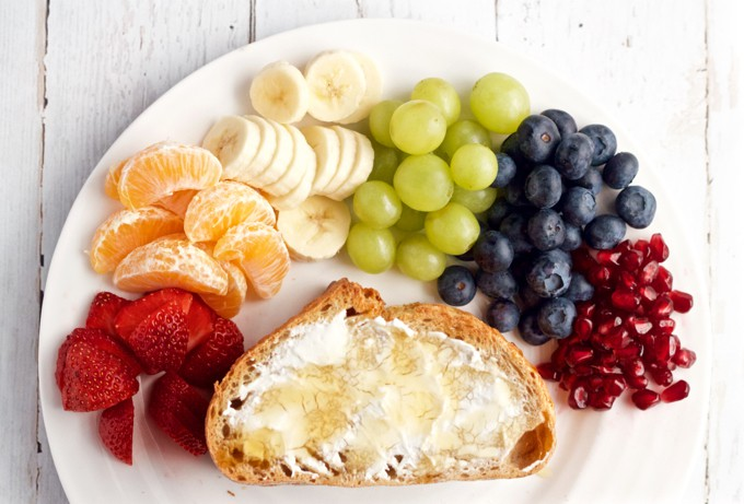 Rainbow fruit - A fun fruit toast with cream cheese, honey and all the colors of the rainbow! | FamilyFoodontheTable.com