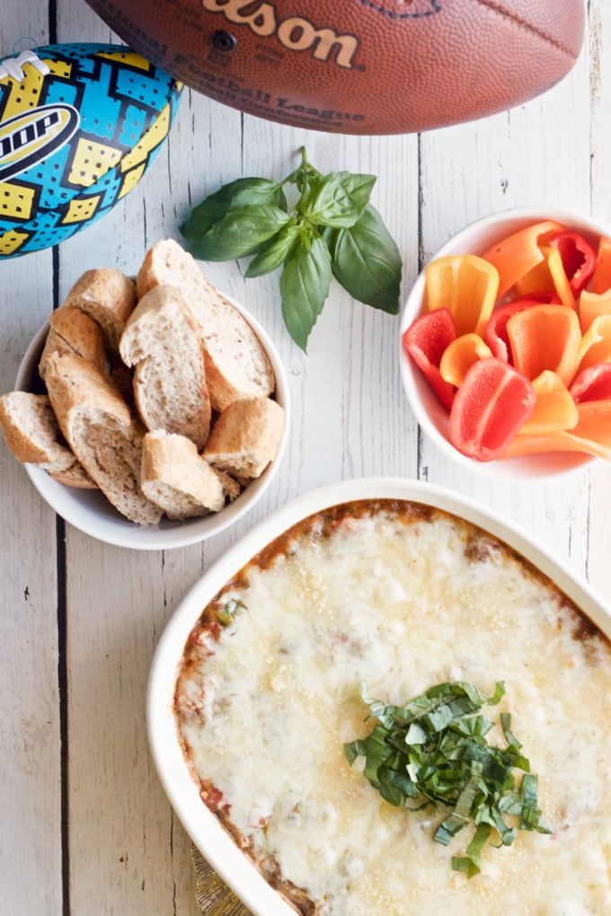 Veggie loaded pizza dip - super easy to make (and can be prepped ahead) | FamilyFoodontheTable.com