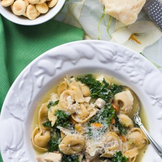 A one-pot chicken tortellini soup that's ready in 20 minutes - an easy weeknight dinner! | FamilyFoodontheTable.com