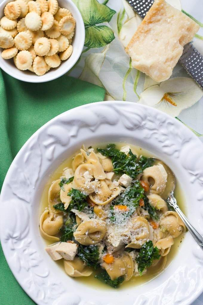 A one-pot chicken tortellini soup that's ready in 20 minutes - an easy weeknight dinner!   FamilyFoodontheTable.com