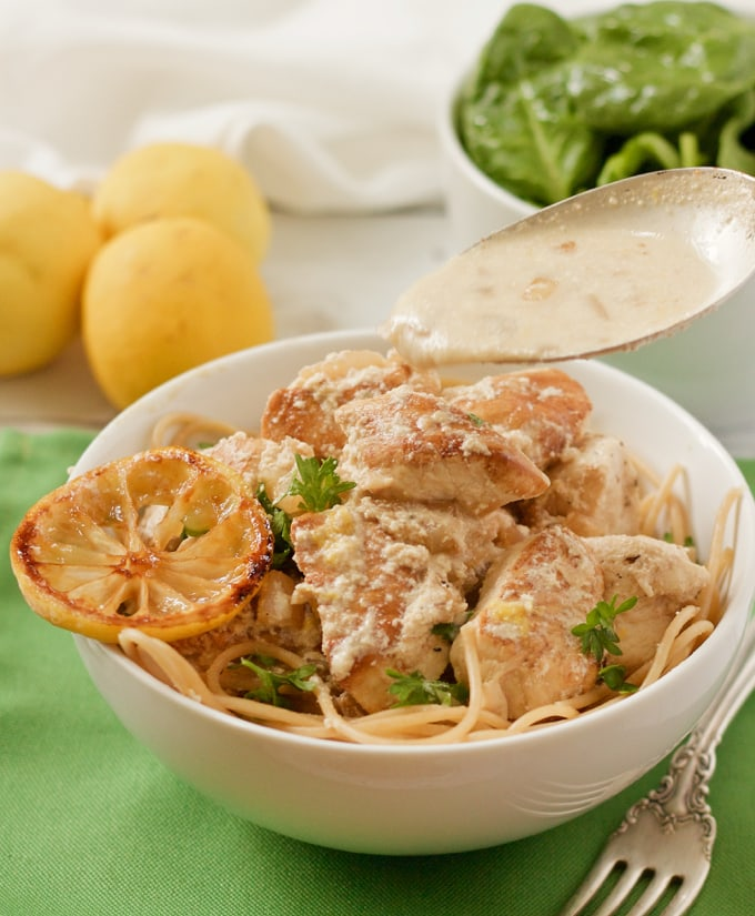 Creamy lemon chicken and pasta with a light but luscious goat cheese sauce | FamilyFoodontheTable.com