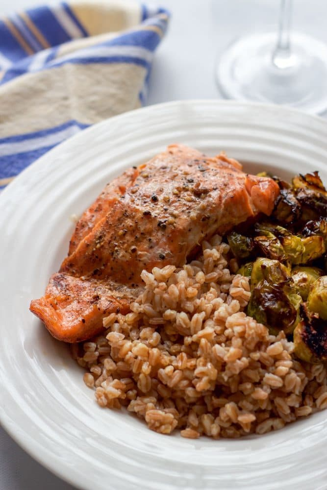 Easy roasted balsamic salmon with Brussels sprouts and farro makes for a delicious and healthy weeknight dinner!