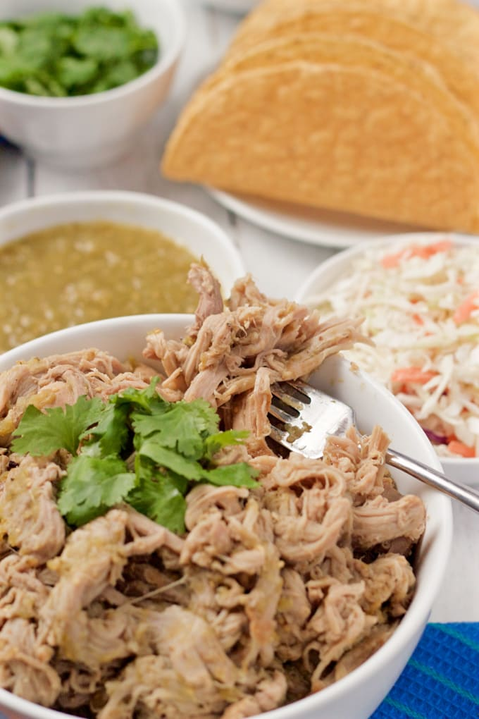 Slow cooker salsa verde shredded pork - great for tacos, rice bowls, quesadilla and nachos! | FamilyFoodontheTable.com