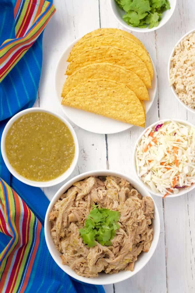 Slow cooker salsa verde shredded pork is great for tacos, rice bowls, quesadilla and nachos! #slowcooker #crockpot #porkrecipes #porktacos