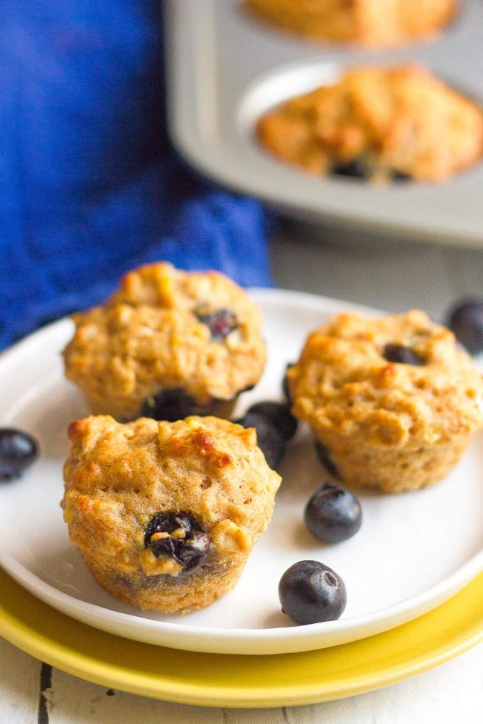 Whole grain, naturally sweetened banana blueberry muffins that are bursting with fresh, fruit flavor! | FamilyFoodontheTable.com